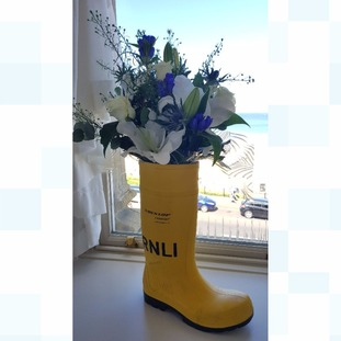 RNLI themed flowers at the wedding reception
