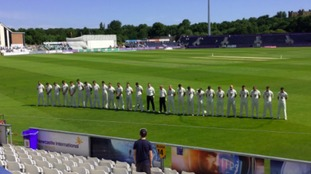 The cricket team in Durham observes the silence