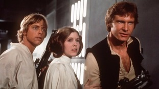 Mark Hamill, Carrie Fisher and Harrison Ford in Star Wars in 1977.