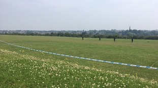 Police search football pitch in Kings Heath for clues.
