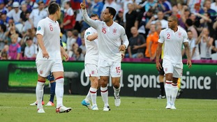 England's Joleon Lescott (centre) celebrates after he scores the opening goal of the game against France in June