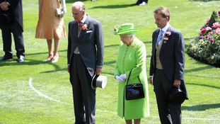 Queen leads minute's silence to victims of tragedies