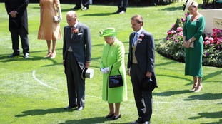 The Queen, The Duke of Edinburgh and Ascot Chairman Johnny Weatherby observe a minute's silence