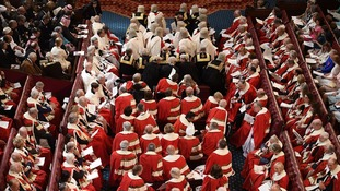 Peers take their seats in the House of Lords.