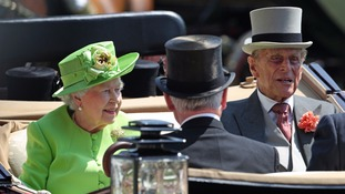 Queen's busy day shows Prince Philip's illness not too serious