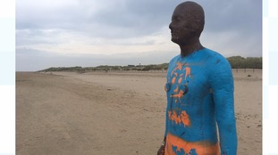 Iron man on Crosby beach has had clothes painted on