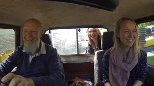 Michael Eavis drives Emily and Kylie Pentelow