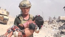 Aid worker rescues child while under IS sniper fire