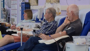 Donors giving blood at The Cambridge Blood Donor Centre.