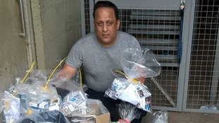 Trading Standards officer Mohammed Tariq with the illegal cigarettes