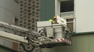 firefighters removing cladding