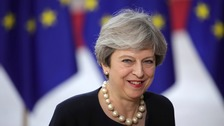 May outlines plans on status of EU citizens living in UK