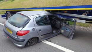 Lucky escape after car slides under lorry on motorway