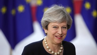 May offers EU migrants right to stay after Brexit