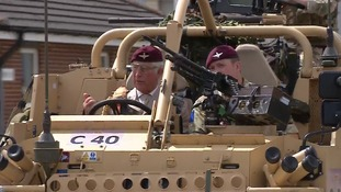 Prince Charles took the wheel of a Jackal armoured vehicle during his visit to Colchester Barracks.