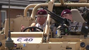 Prince Charles driving an armoured vehicle on a visit to Colchester Barracks.