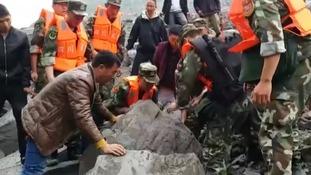 Fears for over 100 missing after China landslide