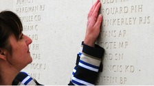 Margaret Allen touches the name of her late husband, Able Seaman Iain Boldy at the National Memorial Arboretum in Staffordshire.