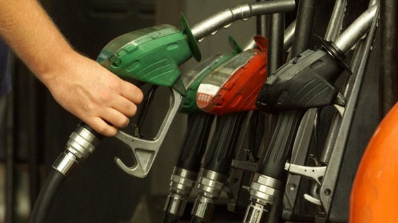 A man uses petrol pumps