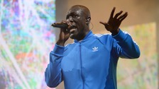 Stormzy uses Glastonbury set to demand Grenfell answers