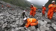 Scores missing after deadly landslide buries Chinese village