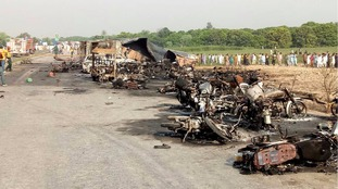 At least 153 dead in Pakistan explosion as they collected fuel from overturned oil tanker