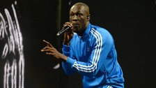Stormzy marks Grenfell disaster in Glastobury set