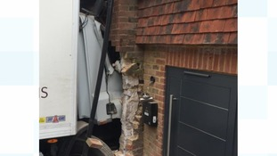Lorry crashes into house in Sussex - three people taken to hospital
