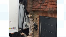 Lorry crashes into house in Sussex