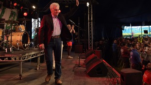 Shadow chancellor John McDonnell spoke in front of a crowd of thousands at Glastonbury Festival.