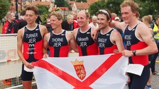Dan Halksworth (centre) retained his triathlon title in Gotland.