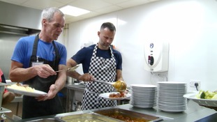 Ryan Giggs helps serve meals at the Booth Centre