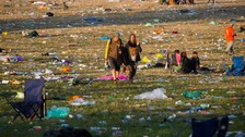 Clean-up begins at Glastonbury site as revellers head home