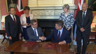 DUP sign pact at Downing Street in return for £1.5bn spending power