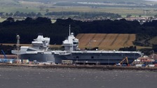 HMS Queen Elizabeth sits in dock ahead of her maiden launch