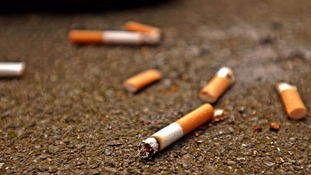 The woman was seen dropping a cigarette outside the bus station