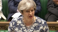 May spells out post-Brexit offer for EU citizens in UK