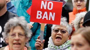 US Supreme Court reinstates 'most of' Donald Trump's travel ban