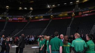 Prince Charles speaks to medical staff.