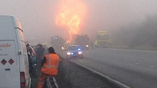 Huge flames surround the tanker after the crash
