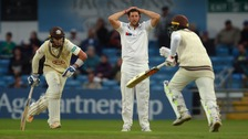 Yorkshire's Tim Bresnan holds his head as Surrey's Tom Curran and Kumar Sangakkara score more runs.