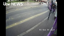 Pedestrian's incredible escape after bus crash
