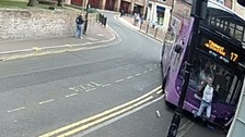 Miraculous escape as man hit by bus gets up and walks away