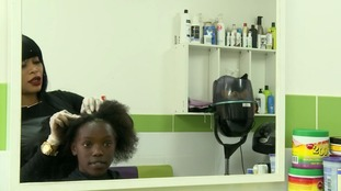 Pressures on young black women and girls to alter afro hair
