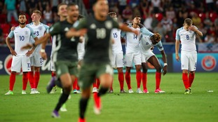 England looked dejected after watching Redmond miss from the spot.