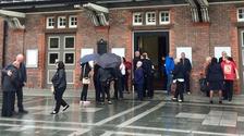Families arrive at Parr Hall, Warrington