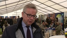 Michael Gove meets farmers at rainy Royal Norfolk show