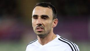 Leon Britton signs improved contract with Swansea City