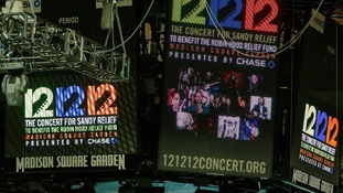 Signs are lit on the scoreboard for the 12-12-12 fundraising concert at Madison Square Garden t