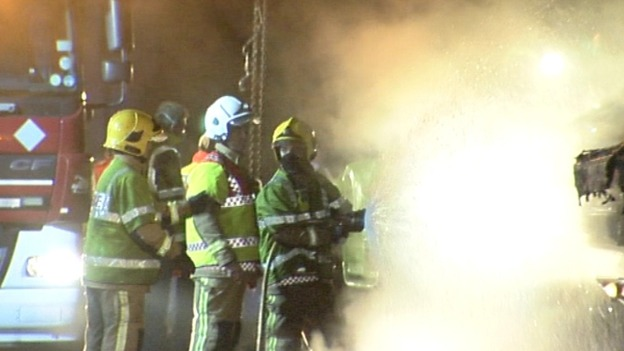 Firefighters dampen the fire